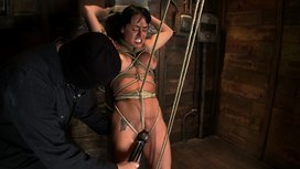 Hot-sexy-Hawaiian-is-bound-to-a-pole-lifted-to-her-tip-toes-with-a-brutal-crotch-rope-Made-to-cum